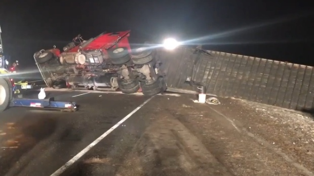 Trucker charged in Hwy. 401 rig flip