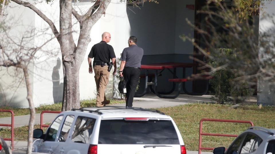 Law enforcement officers enter Marjory Stoneman Douglas High School, Thursday, Feb. 15, 2018 in Parkland, Fla. (AP Photo/Wilfredo Lee)