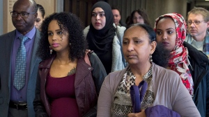 A Feb. 15, 2018 photo of Abdoul Abdi's sister, Fatouma Abdi, second from left, heading from Federal Court with supporters after a hearing to determine whether deportation proceedings should be halted for the former child refugee, in Halifax.  (THE CANADIAN PRESS/Andrew Vaughan)