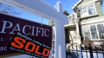 A real estate sold sign is shown outside a house in Vancouver, Tuesday, Jan.3, 2017. THE CANADIAN PRESS/Jonathan Hayward