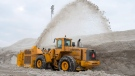 A snowblower piles snow at the city's newest dump at Blue Bonnets as snow removal operations continue Wednesday, February 14, 2018 in Montreal. THE CANADIAN PRESS/Ryan Remiorz