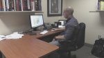Western University Professor and Criminologist Mike Arntfeld at a desk