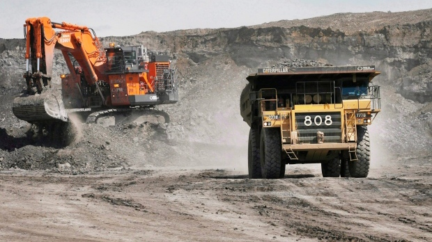 A haul truck carrying a full load drives at an oilsands mine near Fort McMurray, Alta., in 2008. (Jeff McIntosh / THE CANADIAN PRESS)