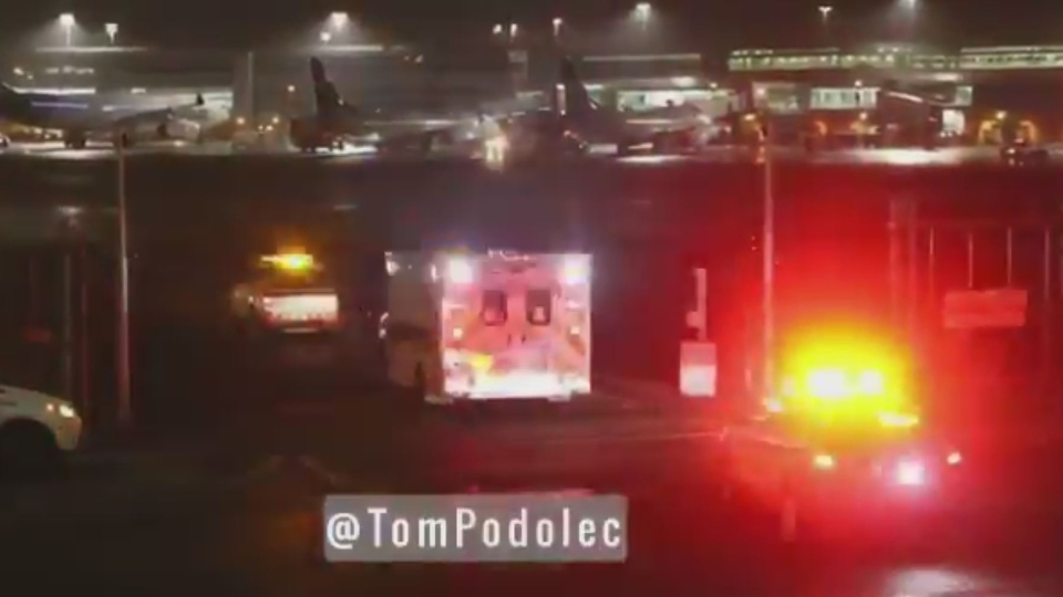 Ambulances are seen at Toronto Pearson International Airport after a plane landed following a spell of intense turbulence that injured several people on board. (Source: Tom Podolec, Twitter)