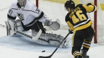 Pittsburgh Penguins' Zach Aston-Reese can't get a shot past Los Angeles Kings goaltender Jonathan Quick during the first period of an NHL hockey game in Pittsburgh on Thursday, Feb. 15, 2018. (AP Photo/Gene J. Puskar)