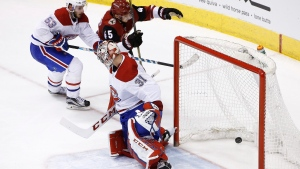 Arizona Coyotes right wing Josh Archibald (45) scores a goal against Montreal Canadiens goaltender Carey Price (31) as Canadiens defenseman Victor Mete (53) arrives late to help during the third period of an NHL hockey game Thursday, Feb. 15, 2018, in Glendale, Ariz. The Coyotes defeated the Canadiens 5-2. (AP Photo/Ross D. Franklin)