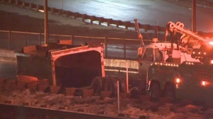 Two lanes on Aut-25 were temporarily closed after a dump truck struck an overpass on Thursday night.