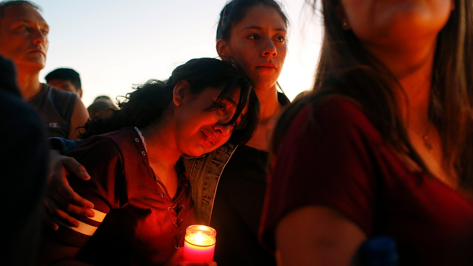 Students gather during a vigil at Pine Trails Park for the victims of the Wednesday shooting at Marjory Stoneman Douglas High School, in Parkland, Fla., Thursday, Feb. 15, 2018. (AP Photo/Brynn Anderson)