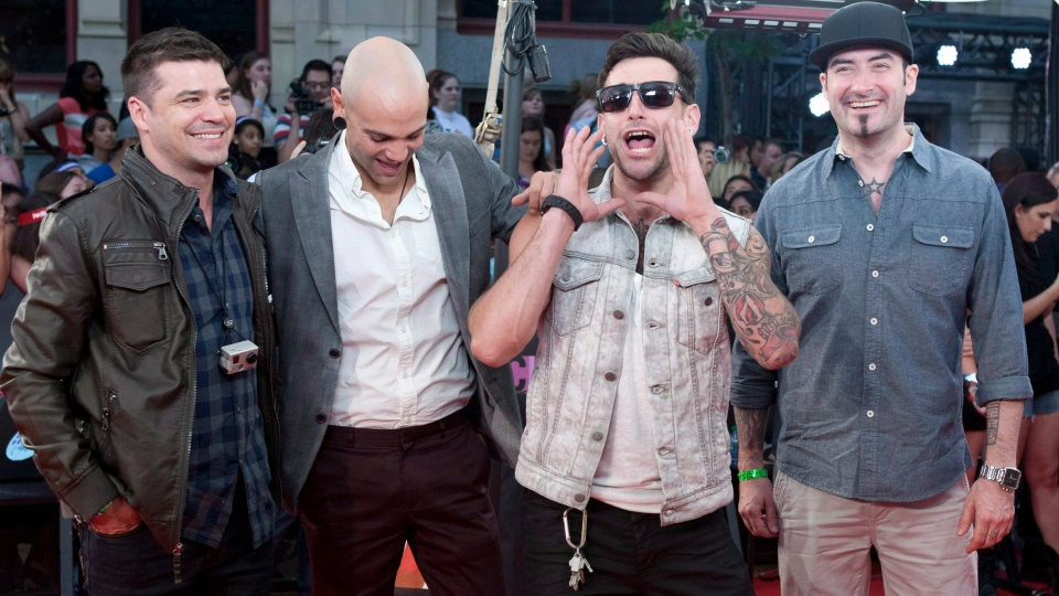 Hedley pose on the red carpet during the 2012 Much Music Video Awards in Toronto on Sunday, June 17, 2012. (File/ THE CANADIAN PRESS)