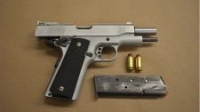 A .45 calibre handgun is shown in a handout image. (TPS)