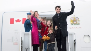 Prime Minister Justin Trudeau, right, departs Ottawa with his wife Sophie Gregoire Trudeau, left to right, and children Xavier, Ella-Grace and Hadrien on Friday, Feb. 16, 2018., en route to India. THE CANADIAN PRESS/Sean Kilpatrick