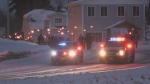People parade through Cochrane with torch lights