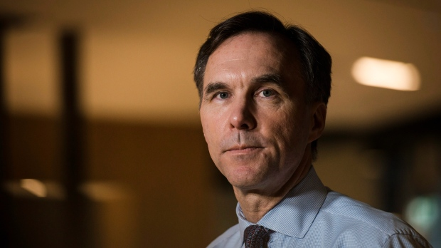 Minister of Finance Bill Morneau speaks to media after meeting with private sector economists, in Toronto on Friday, February 16, 2018. (THE CANADIAN PRESS/Christopher Katsarov)