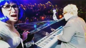 Caught on cam: Elton John hit in the face with nec
