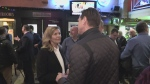 PC leader hopeful Christine Elliot speaks with a man