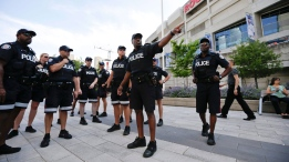 Toronto police meet in front of the Rogers Centre before the opening ceremony for the Pan Am Games in Toronto, Friday, July 10, 2015. (AP /Gregory Bull)