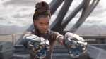 """This image released by Disney -Marvel Studios shows Letitia Wright in a scene from """"Black Panther."""" (Matt Kennedy/Disney/Marvel Studios via AP)"""