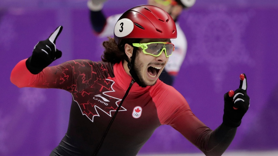 Samuel Girard of Canada celebrates as he crosses the finish line to win the gold medal in men's 1,000 meters short-track speedskating final in the Gangneung Ice Arena at the 2018 Winter Olympics in Gangneung, South Korea, Saturday, Feb. 17, 2018. (AP Photo/Julie Jacobson)