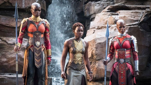 """This image released by Disney-Marvel Studios shows, from left, Danai Gurira, Lupita Nyong'o and Florence Kasumba in a scene from """"Black Panther."""" (Matt Kennedy/Disney/Marvel Studios via AP)"""