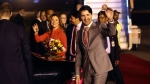 Canadian Prime Minister Justin Trudeau and his wife, Sophie Gregoire Trudeau, wave upon their arrival at the Palam Air Force Station in New Delhi, India, Saturday, Feb. 17, 2018. (AP Photo/Manish Swarup)
