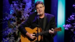 In this Sept. 14, 2017 file photo, Vince Gill performs during a memorial service for country music singer Troy Gentry at the Grand Ole Opry House in Nashville, Tenn. (AP Photo/Mark Humphrey)