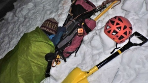 "Serguei Okountsev said his climbing partner spent the night in a ""semi-coma"" after suffering a devastated fall that destroyed her helmet and left her with a broken ankle and injured ribs. (Youtube / Spindle Couloir Rescue)"