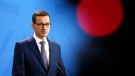 Polish Prime Minister Mateusz Morawiecki speaks during a press conference with German Chancellor Angela Merkel after a meeting in the chancellery in Berlin, Germany, Friday, Feb. 16, 2018. (AP Photo / Ferdinand Ostrop)