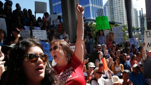Helena Moreno, center, yells during a protest against guns on the steps of the Broward County Federal courthouse in Fort Lauderdale, Fla., on Saturday, Feb. 17, 2018. (AP Photo / Brynn Anderson)