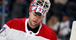 Montreal Canadiens goaltender Antti Niemi pulls up his helmet during a time out against the Colorado Avalanche in the first period of an NHL hockey game Wednesday, Feb. 14, 2018, in Denver. (AP Photo/David Zalubowski)