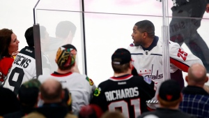 Washington Capitals right wing Devante Smith-Pelly (25) argues with Chicago Blackhawks fans from the penalty box during the third period of an NHL hockey game Saturday, Feb. 17, 2018, in Chicago. (AP Photo/Jeff Haynes)