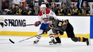 Montreal Canadiens right wing Brendan Gallagher (11) and Vegas Golden Knights left wing Tomas Nosek chase after the puck during the third period of an NHL hockey game Saturday, Feb. 17, 2018, in Las Vegas. (AP Photo/David Becker)