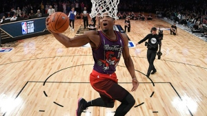 Utah Jazz's Donovan Mitchell competes in the NBA basketball All-Star weekend slam dunk contest Saturday, Feb. 17, 2018, in Los Angeles. Mitchell won the event. (AP Photo/Chris Pizzello, Pool)