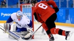 South Korea goaltender Matt Dalton (1) makes the save on Canada forward Wojciech Wolski (8) during second period men's hockey action at the 2018 Olympic Winter Games in Pyeongchang, South Korea, on Sunday, February 18, 2018. THE CANADIAN PRESS/Nathan Denette