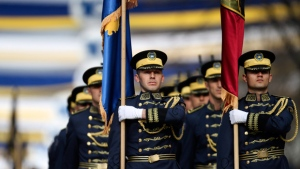 Kosovo Security Force members march during a military and police force parade in Kosovo capital Pristina on Sunday Feb. 18, 2018, marking the 10th anniversary of the country's independence. (AP Photo/Visar Kryeziu)