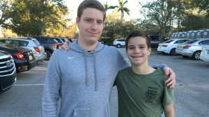 Brothers Jack, left, and James Ciaramello pose at Pine Trails Park in Parkland, Fla., on Friday, Feb. 16, 2018. Jack was in the same Junior Reserve Officer Training Corps company as Nikolas Cruz, who is charged with gunning down 17 people at Marjory Stoneman Douglas High School on Valentine's Day. (AP Photo/Allen G. Breed)