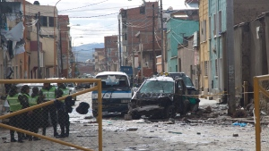Police stand guard at the site of an explosion in Oruro, Bolivia, Thursday, Feb. 15, 2018. (AP Photo/Juan Karita)