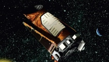 FILE - This file artist's rendering provided by NASA shows the Kepler space telescope. The Kepler spacecraft lost the second of four wheels that control the telescope's orientation in space, NASA said Wednesday, May 15, 2013. If engineers can't find a fix, the failure means Kepler won't be able to look for exoplanets — planets outside our solar system anymore. (AP / NASA, File)