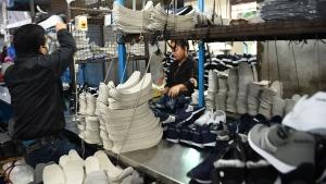 Employees working at a factory of Nepali shoe brand Goldstar in Kathmandu (PRAKASH MATHEMA / AFP)