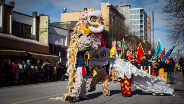 Lion dancers perform during the 45th annual Chinese Lunar New Year Parade in Vancouver, B.C., on Sunday February 18, 2018. More than 100,000 people were expected to attend the parade, which is one of the largest in North America according to organizers. (THE CANADIAN PRESS / Darryl Dyck)