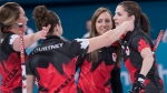 Canada's Emma Miskew, Joanne Courtney, skip Rachel Homan and Lisa Weagle, left to right, celebrate their victory over Switzerland in preliminary round in women's curling at the Pyeongchang 2018 Olympic Winter Games in Gangneung, South Korea, on Sunday, February 18, 2018. (THE CANADIAN PRESS/Paul Chiasson)