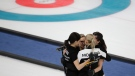 Olympic Athletes from Russia Uliana Vasileva, Galina Arsenkina, Victoria Moiseeva and Julia Guzieva embrace each other during a women's curling match against Britain at the 2018 Winter Olympics in Gangneung, South Korea, Wednesday, Feb. 14, 2018. (AP Photo/Natacha Pisarenko)