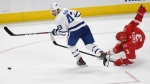 Toronto Maple Leafs center Nazem Kadri (43) keeps the puck away from Detroit Red Wings defenseman Nick Jensen (3) during the third period of an NHL hockey game, Sunday, Feb. 18, 2018, in Detroit. The Maple Leafs defeated the Red Wings, 3-2. (AP Photo/Jose Juarez)