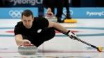Russian curler Alexander Krushelnitsky practices ahead of the 2018 Winter Olympics in Gangneung, South Korea on Feb. 7, 2018. (AP Photo/Aaron Favila, File)