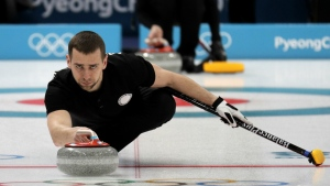 Russian curler Alexander Krushelnitsky practices ahead of the 2018 Winter Olympics in Gangneung, South Korea on Feb. 7, 2018. (AP Photo/Aaron Favila, File)