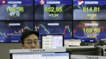 A currency trader works at the foreign exchange dealing room of the KEB Hana Bank headquarters in Seoul, South Korea, Monday, Feb. 19, 2018. (AP Photo/Ahn Young-joon)