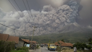 Mount Sinabung spews volcanic ash as it erupts in Kutarakyat, North Sumatra, Indonesia, Monday, Feb. 19, 2018. (AP Photo/Endro Rusharyanto)