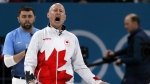 Canada's skip Kevin Koe reacts during their men's curling match against U.S. at the 2018 Winter Olympics in Gangneung, South Korea on Monday, Feb. 19, 2018. (AP Photo/Aaron Favila)