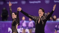 Canada's Tessa Virtue and Scott Moir salutes the crowd following their performance the ice dance figure skating short program at the Pyeongchang Winter Olympics Monday, Feb. 19, 2018 in Gangneung, South Korea. (THE CANADIAN PRESS/Paul Chiasson)