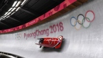 Canadians Justin Kripps and Alexander Kopacz race down the track during the men's two-man bobsled finals at the 2018 Winter Games in Pyeongchang, South Korea, Sunday, Feb. 18, 2018. THE CANADIAN PRESS/Jonathan Hayward