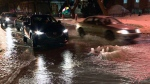 Drivers head through a puddle created by a broken water main at Rachel and De Lorimier on Feb. 19, 2018 (CTV Montreal/Cosmo Santamaria)